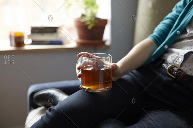 Close up of woman holding mug of tea