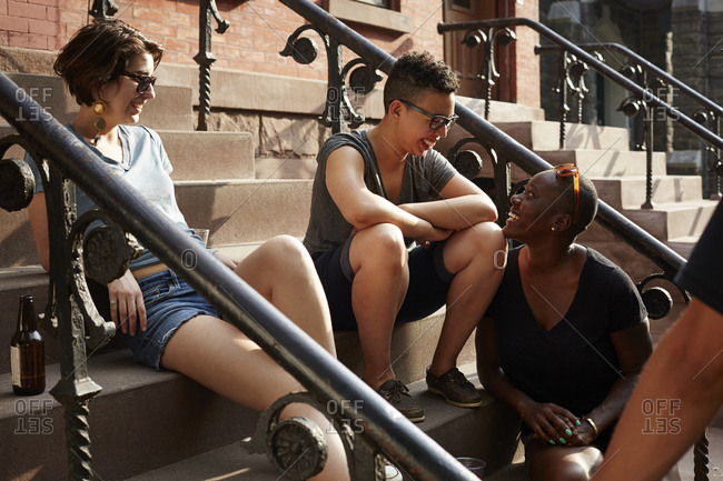 Friends relaxing on front stoop