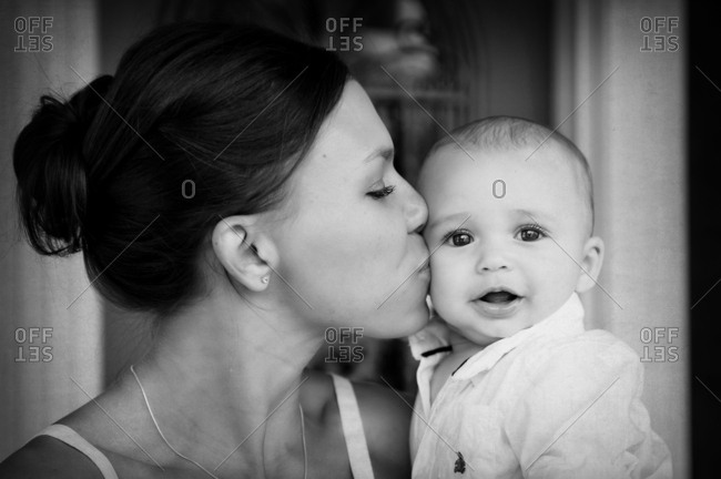 Close up mixed race mother kissing baby son