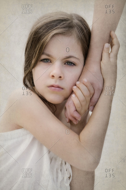 Close up of anxious girl holding hand of mother