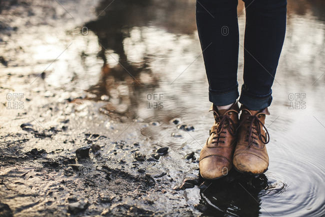 Close up of woman standing in puddle