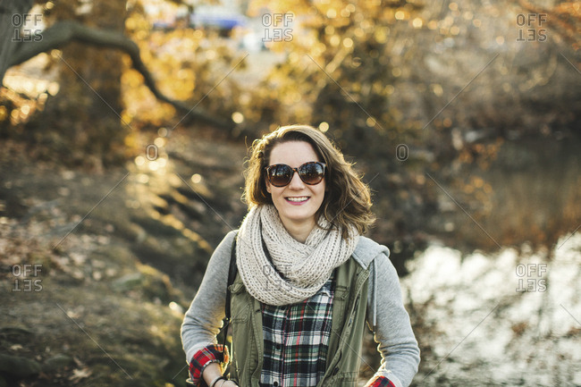 Smiling Caucasian woman walking in park