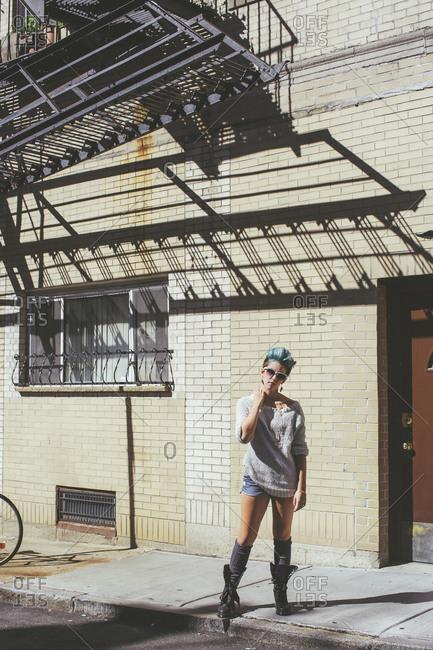 Caucasian woman standing on city sidewalk