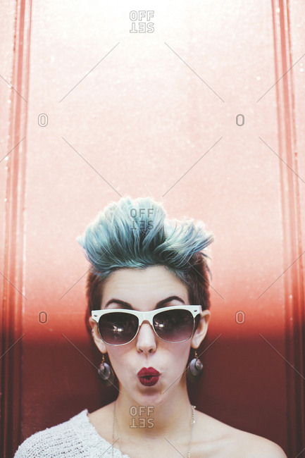 Stylish Caucasian woman with sunglasses and dyed hair