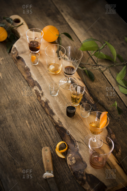 Variety of cocktails on wooden board