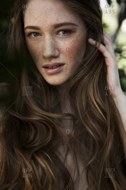 Caucasian woman with long hair and freckles