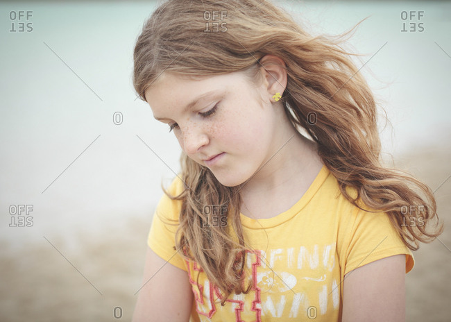 Sad Caucasian girl looking down