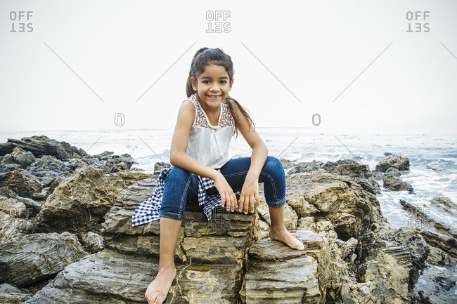 Hispanic girl exploring tide pools