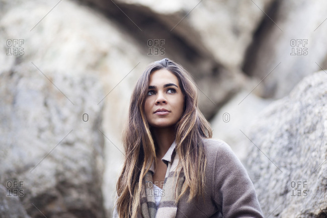 Mixed race woman near rocks