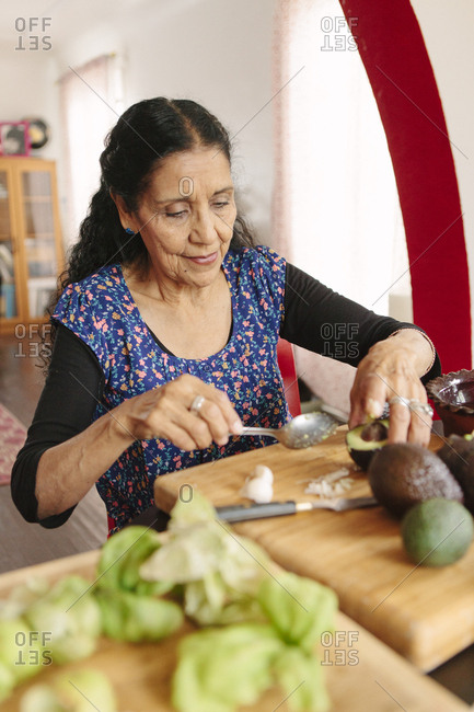 Hispanic woman cooking in kitchen