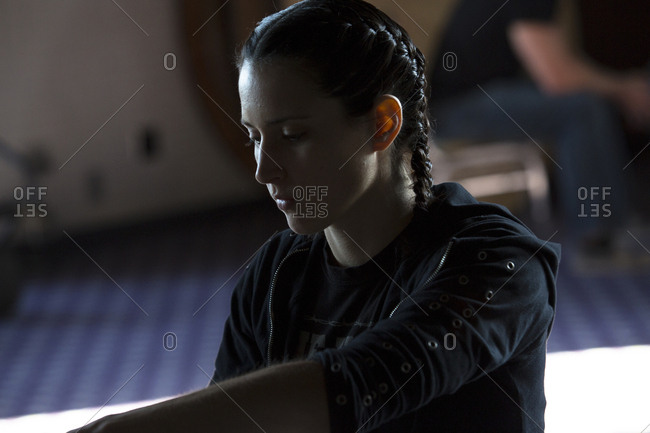 Caucasian woman with braids in gymnasium
