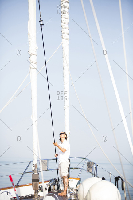 Caucasian woman standing on sailboat deck