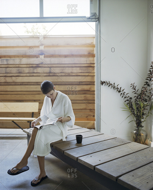 Woman reading magazine in spa