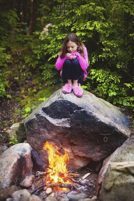 Caucasian girl admiring campfire