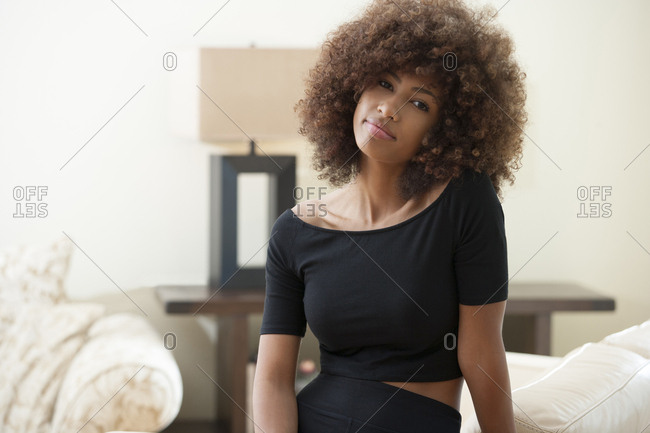 Teenage girl with curly hair indoors