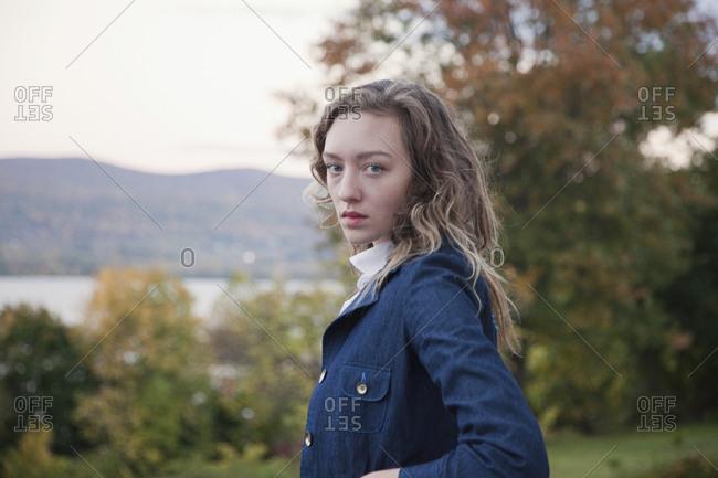 Woman walking outdoors near lake