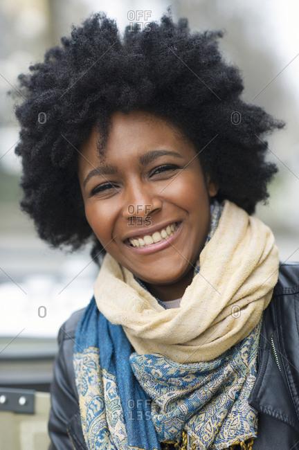 Smiling Black woman wearing scarves