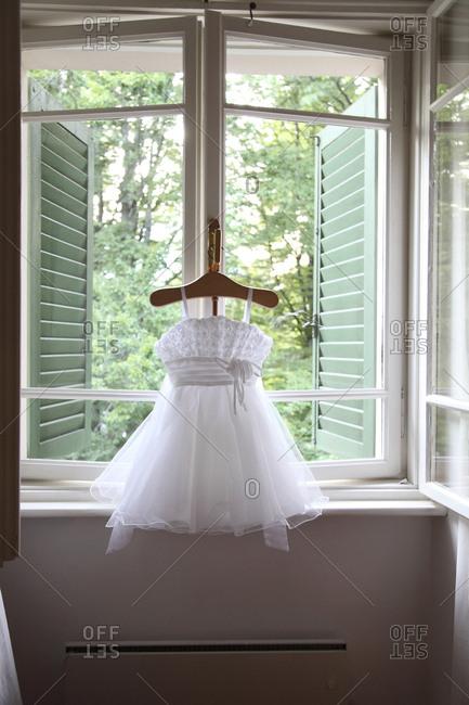 Formal dress hanging in window