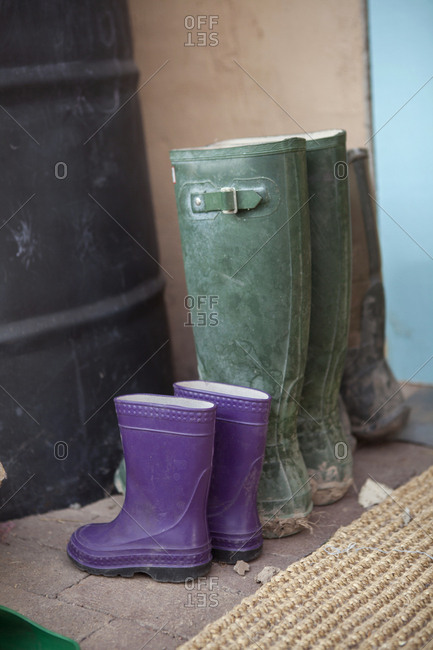 Close up of rain boots of adult and child
