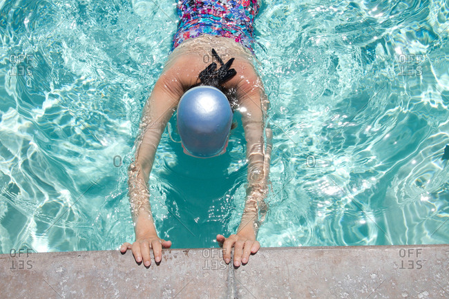 High angle view of Caucasian woman swimming in pool