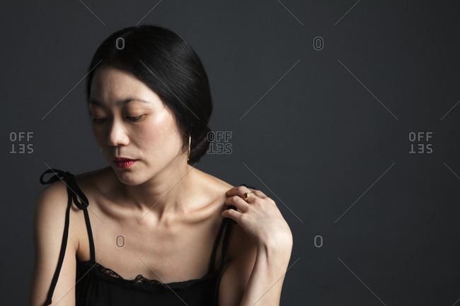 Disappointed Asian woman looking down