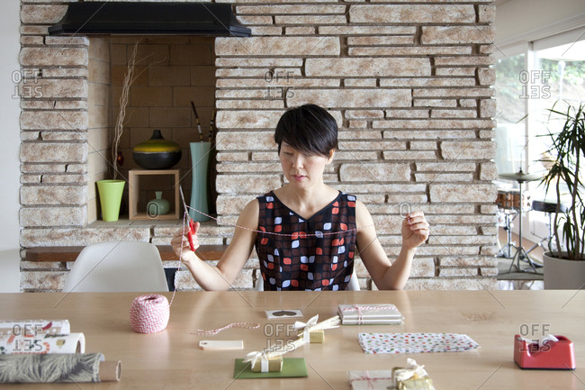 Japanese woman wrapping gifts