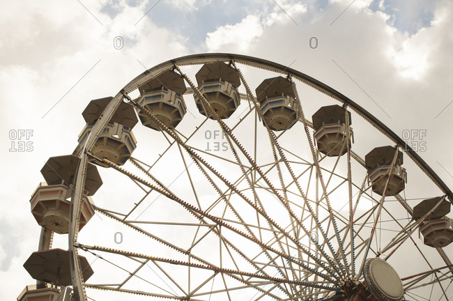 Low angle view of ferris wheel at amusement park