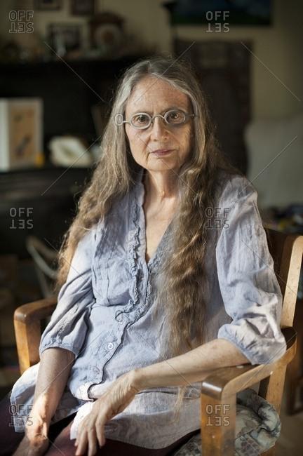 Older woman sitting in living room