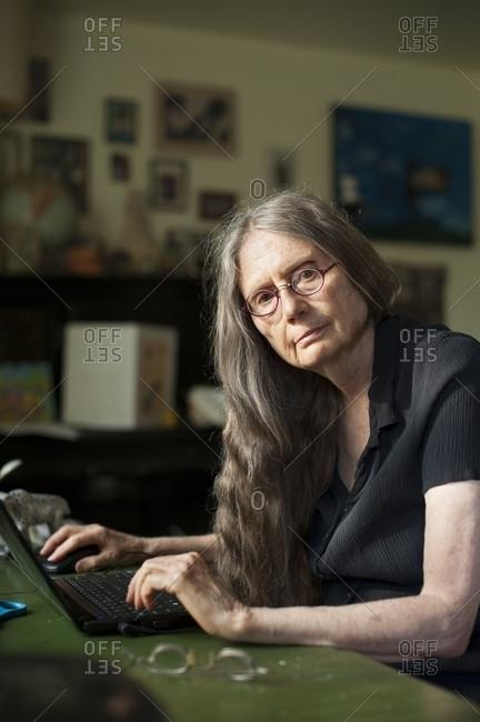 Older woman using laptop at desk