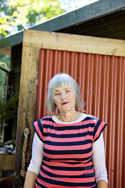 Older Caucasian woman standing in backyard
