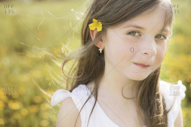 Caucasian girl wearing flower in her hair