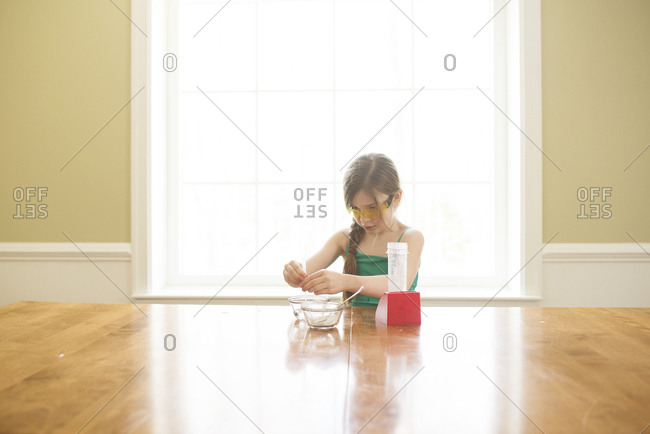 Caucasian girl cooking at table