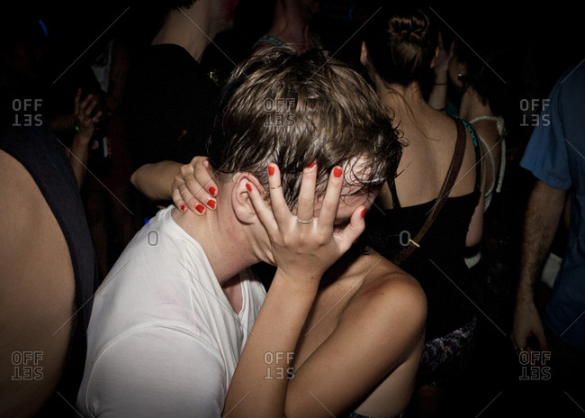 Close up of couple kissing at party