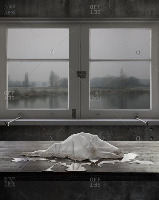 Melting ice on table near window