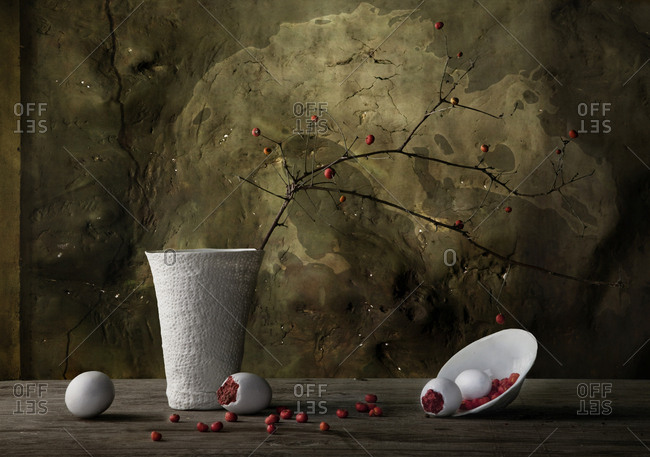Vase and spilling plate with berries