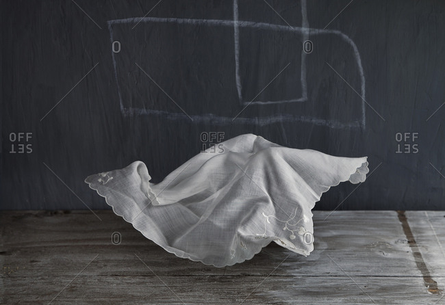 Wrinkled napkin floating near chalkboard