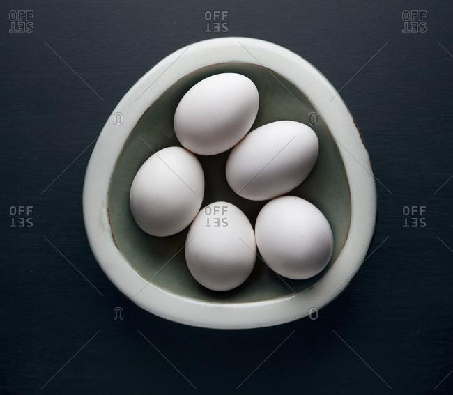 Eggs in ceramic bowl