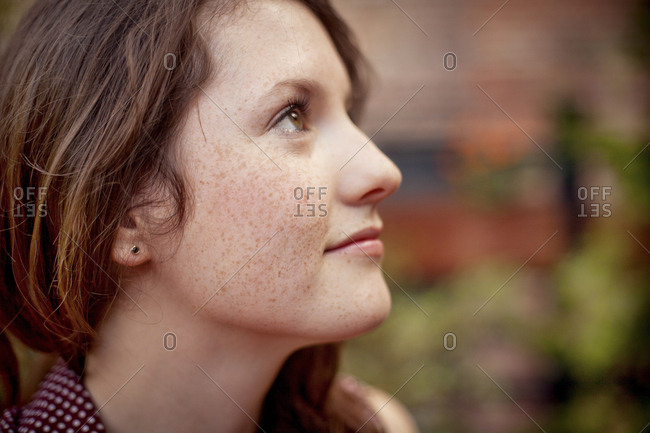 Close up of teenage girl looking up