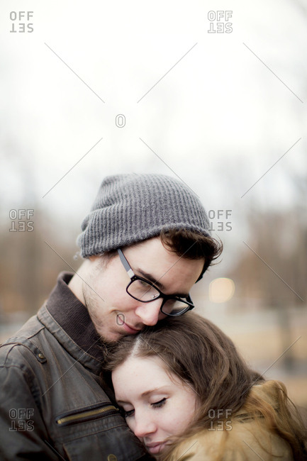 Couple hugging outdoors