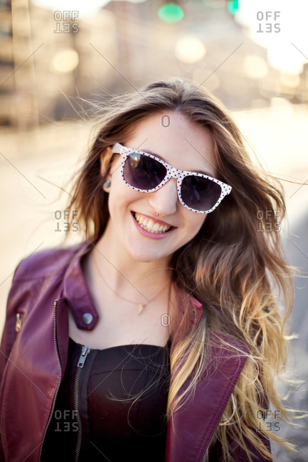 Woman wearing sunglasses in city