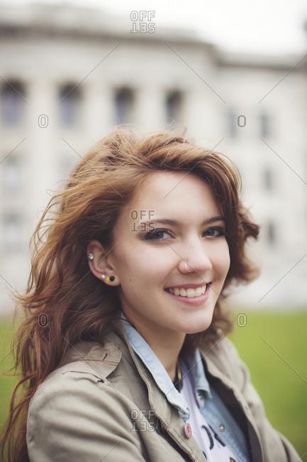 Caucasian student smiling on college campus