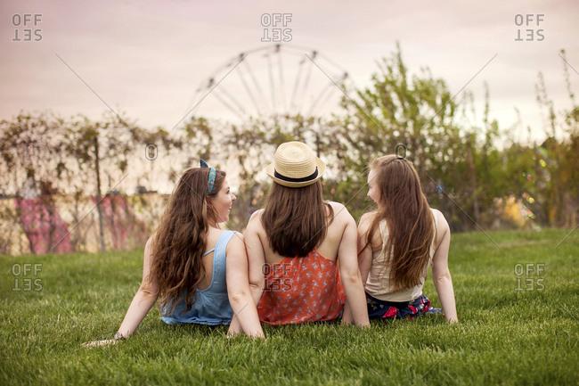 Caucasian women sitting in urban park