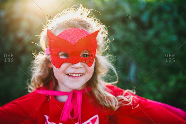 Girl dressed up in superhero costume