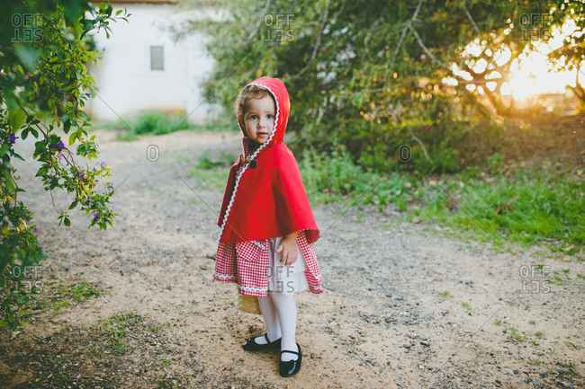 Girl dressed up in little red riding hood costume