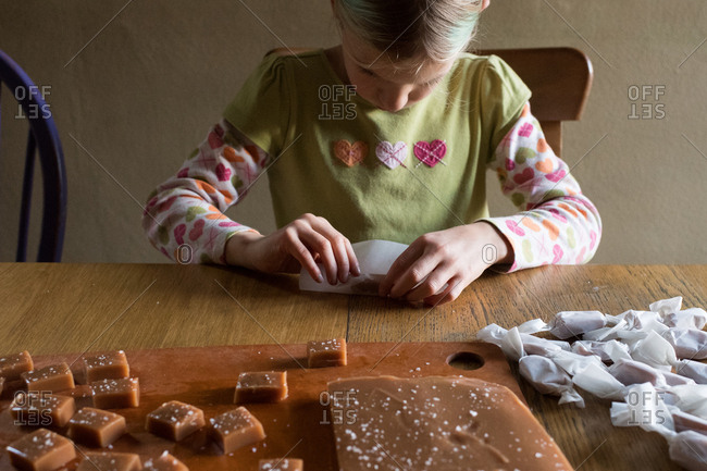 Girl wrapping salted caramels