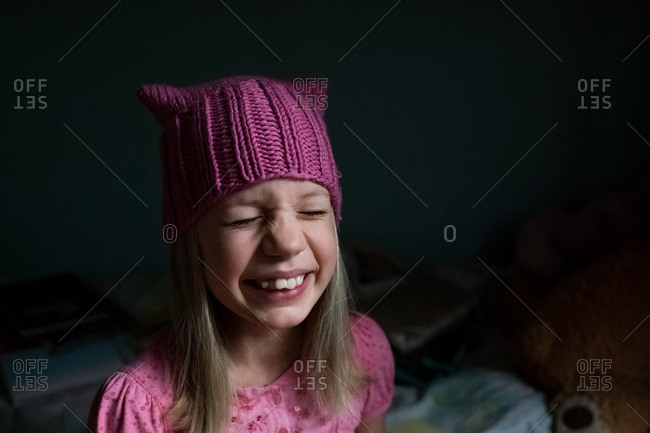 Laughing little girl wearing a