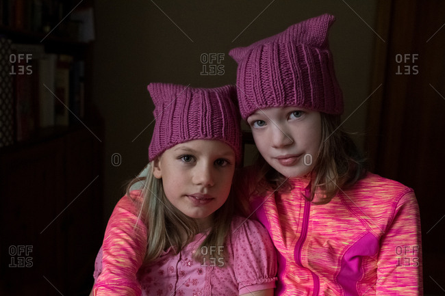 Two sisters wearing pussy hats