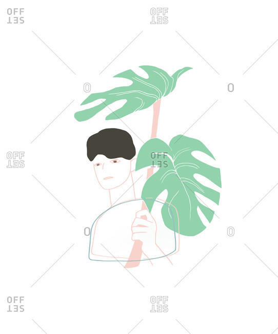 Person holding palm frond above head