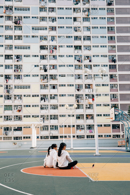 January 24, 2017 - Hong Kong: Two young girls with a selfie stick in the Choi Hung Estate