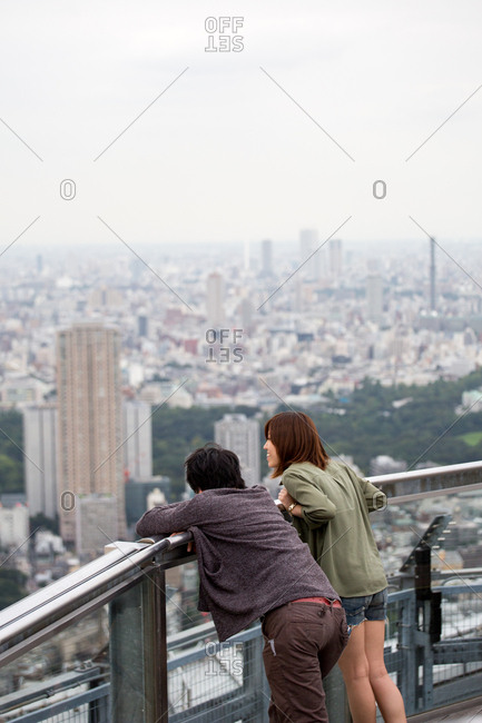 September 30, 2016 - Tokyo, Japan: A couple look over the city from the Roppongi Hills Sky Deck